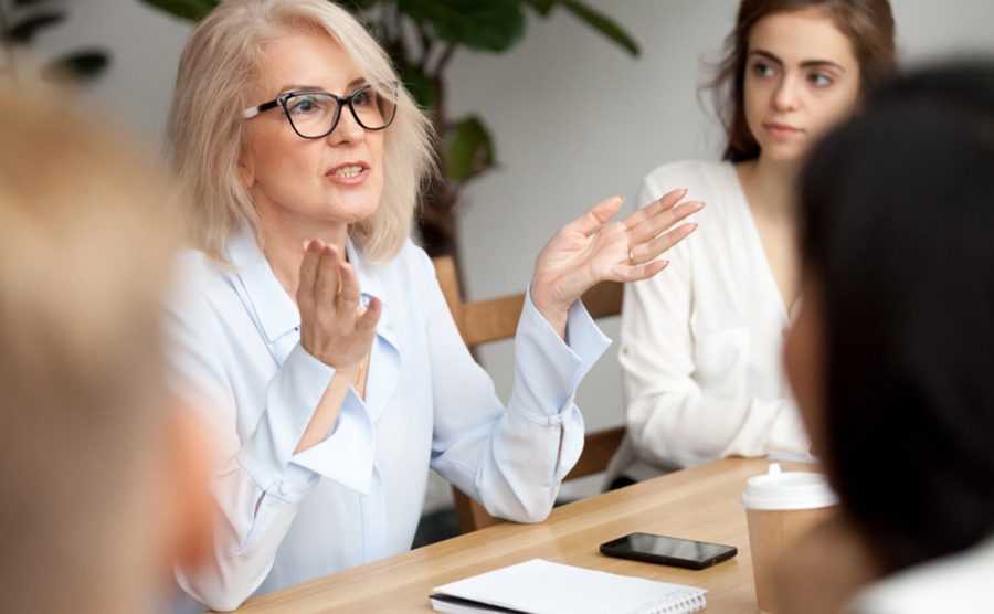 Woman speaking in meeting