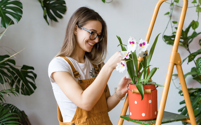 Woman planting flowers in a pot