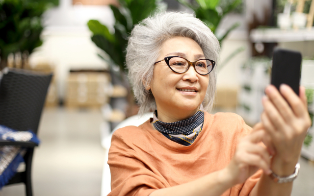 Older woman looking at smart phone